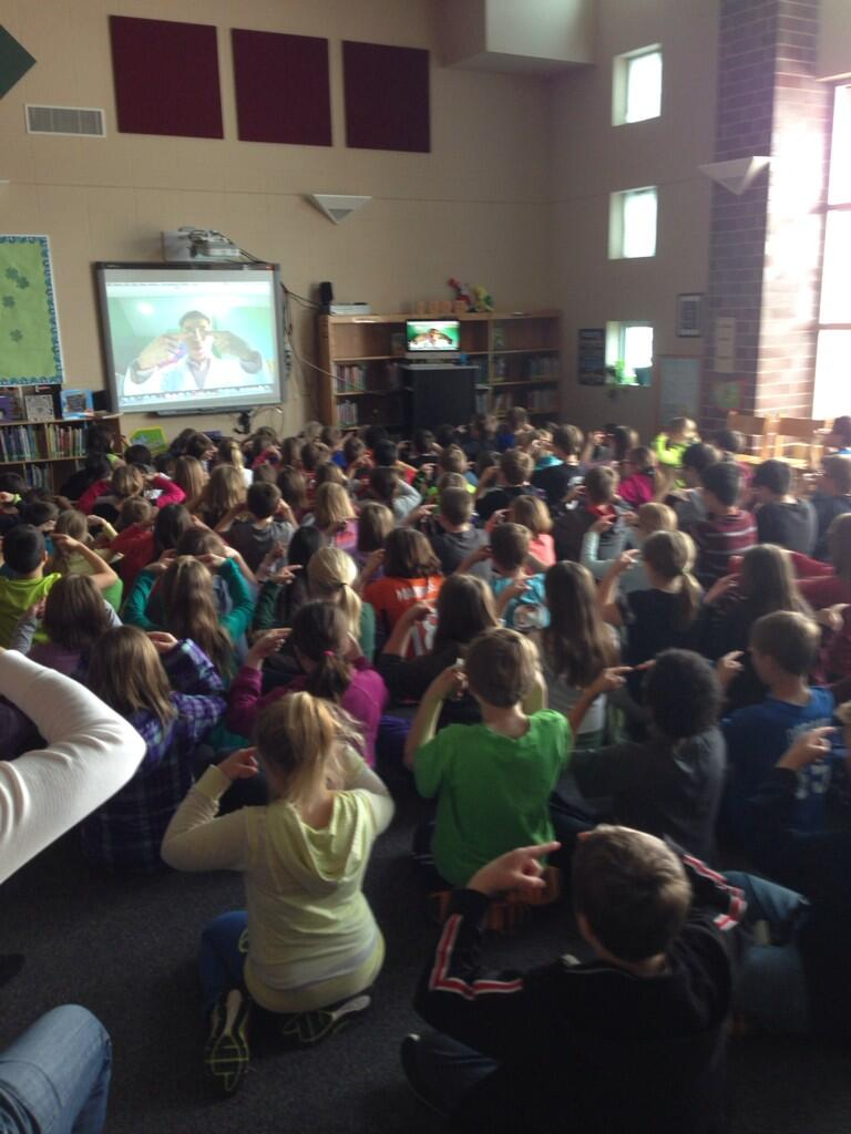 """Explorer Elementary students participate in the """"Floating Finger"""" illusion with Jeff Evans"""