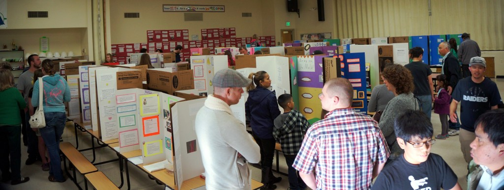 Parents and students explore the various science fair projects.  It's always interesting seeing the creativity of students.