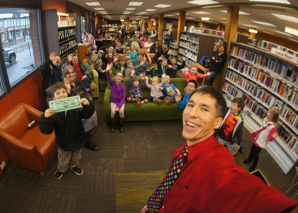 Magician Jeff Evans and fans at the Forks Library