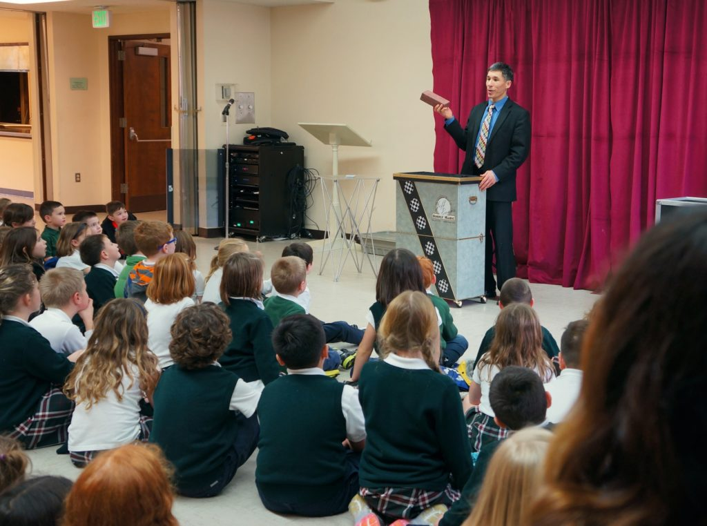 Jeff Evans performs for the St. Nicholas Catholic School in Gig Harbor